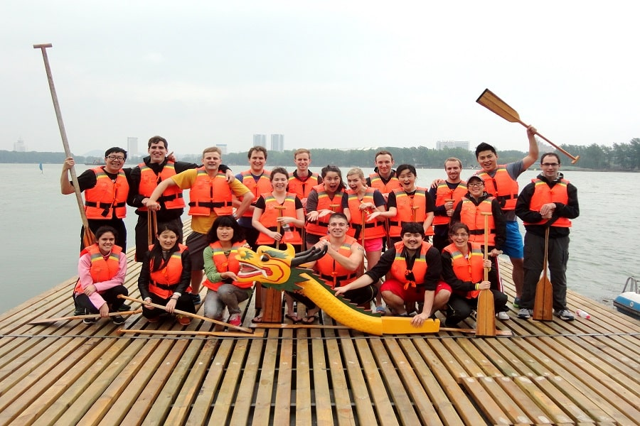 Johns Hopkins SAIS students in life vests after a boat race