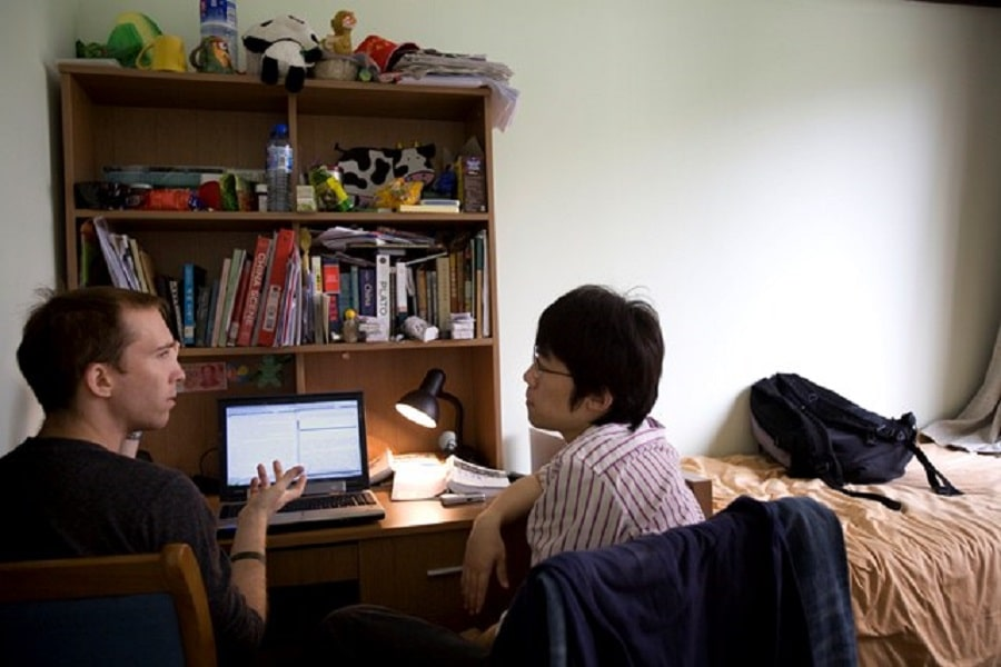 Johns Hopkins SAIS students talking in a dorm room