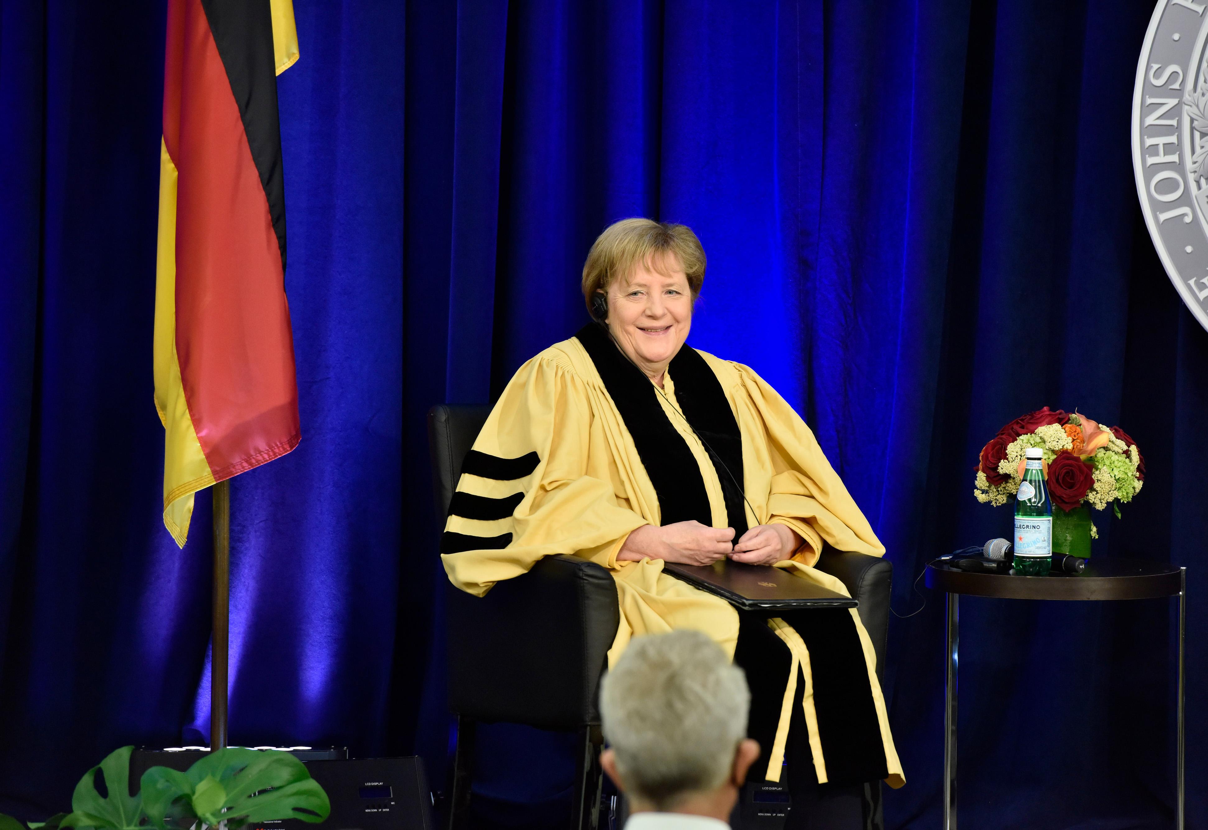 Angela Merkel smiles to the audience