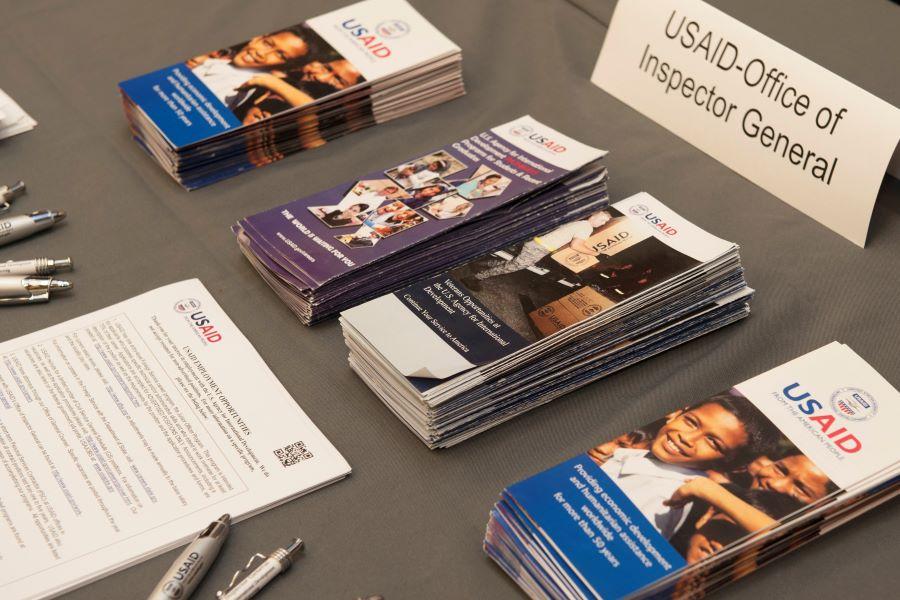 Company brochures on a table