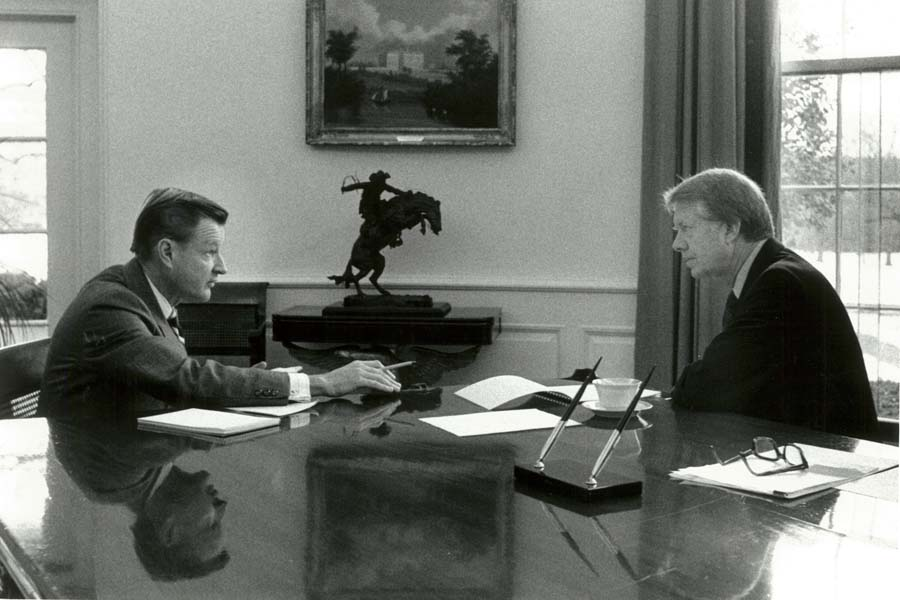 President Carter talking with colleague