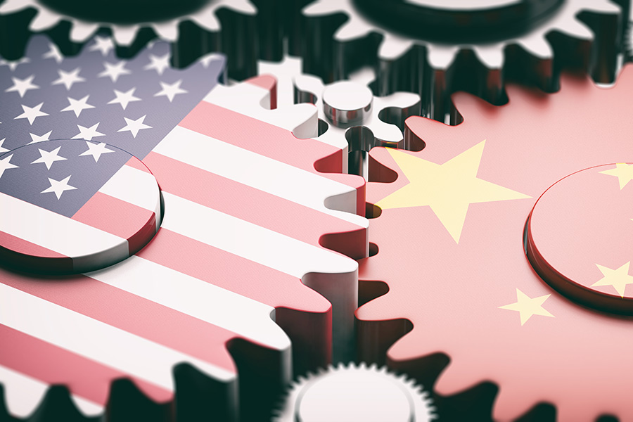 American and Chinese flags in the shapes of gears