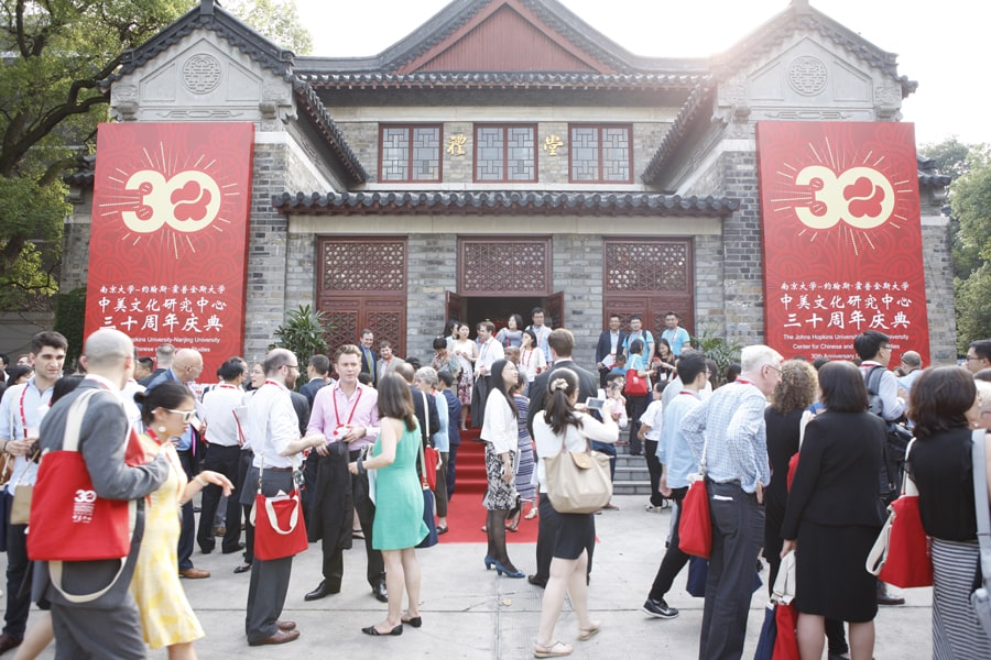 Exterior of a historic building in Nanjing hung with red banners to celebrate the 30th anniversary of the Hopkins-Nanjing Center
