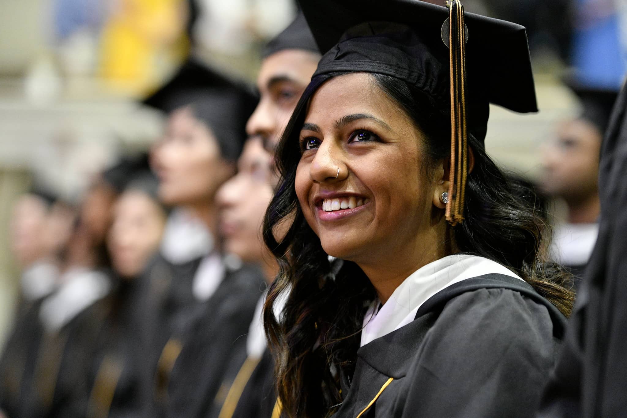 Johns Hopkins SAIS student in cap and gown during commencement