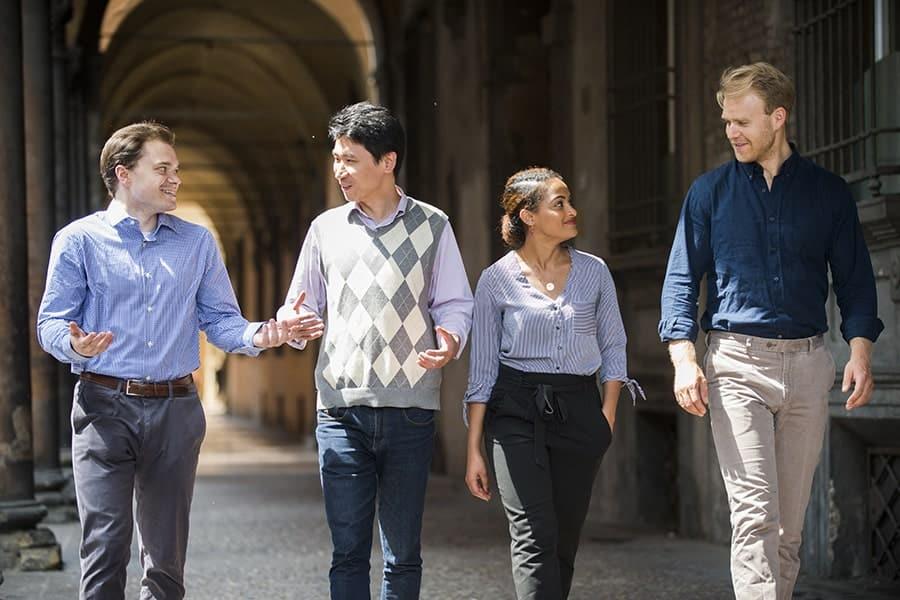 Students walking in porticoes