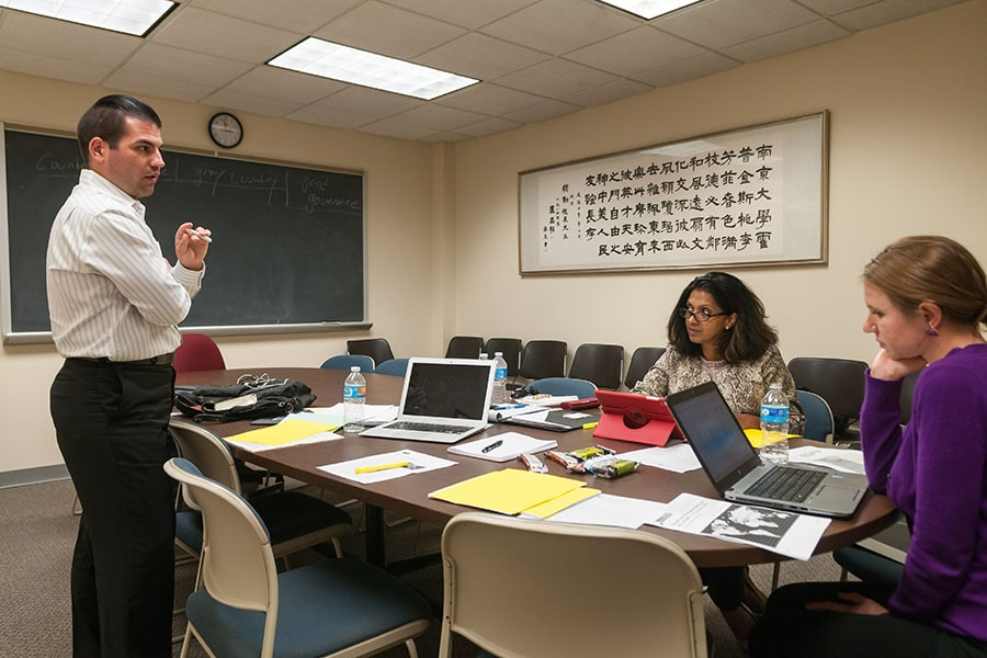 Johns Hopkins SAIS students working on a group project