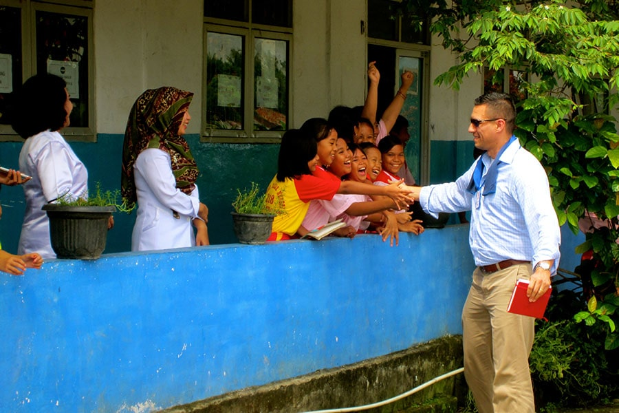Johns Hopkins SAIS student with children in Indonesia