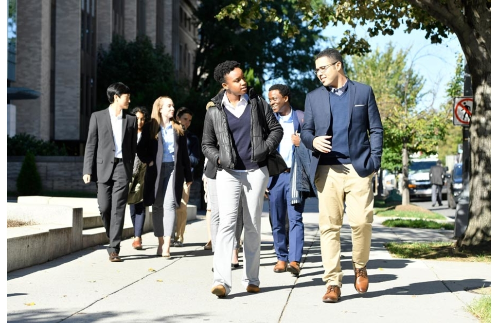 Johns Hopkins SAIS students walk in a group down Massachusetts Avenue