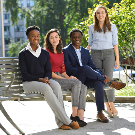 Johns Hopkins SAIS students sitting on a bench