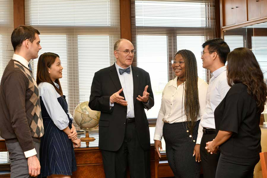 Dean Eliot A. Cohen with Students