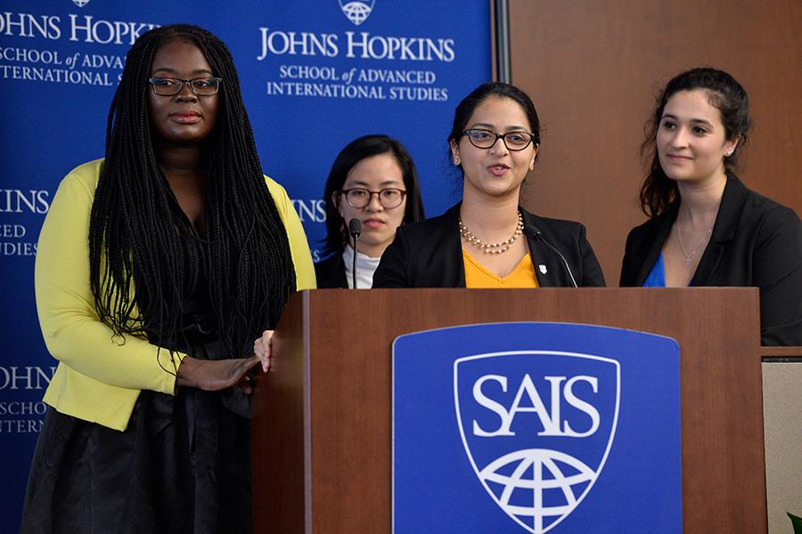 SAIS Women Lead students giving a presentation