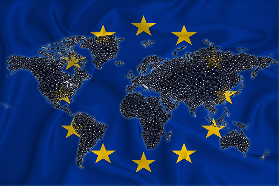 A stock photo depicting a map of the world with an overlay of the EU flag.