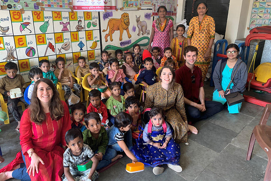 Students visit a school in India to conduct research on the country's take-home rations program.