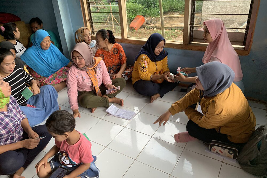 Students visit a village in Indonesia to conduct research on microfinance.