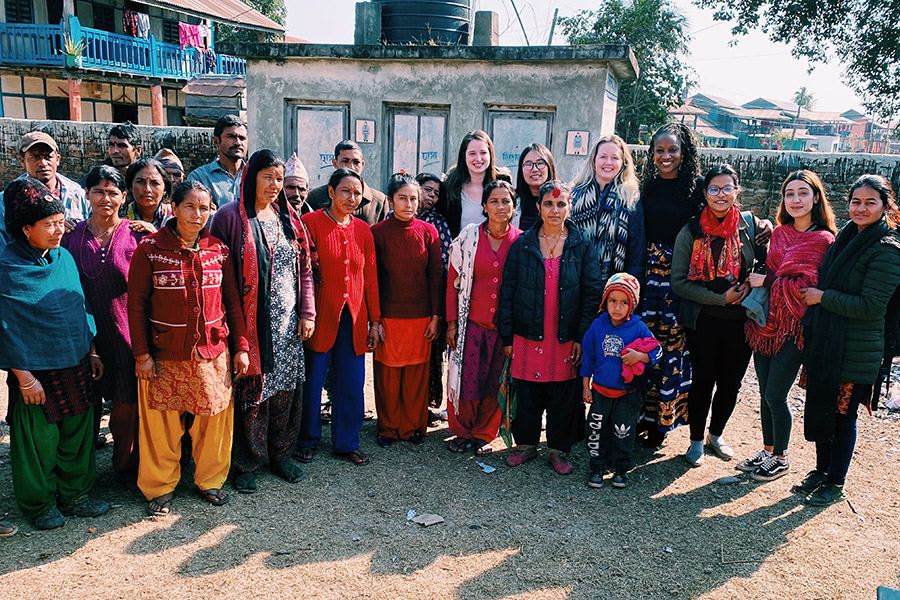 The SAIS Women Lead Nepal Practicum Team take a photo with men and women from the Udayapur Mobile Workshop.