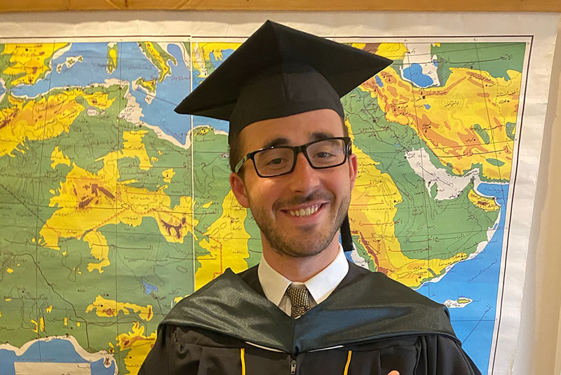 Johns Hopkins SAIS student in Commencement gown and cap